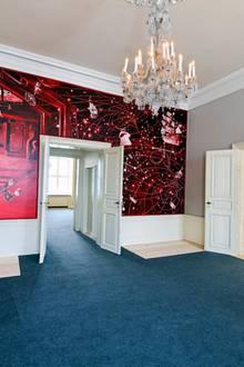 Hinter den Schlossmauern wird es kunterbunt: In dem Empfangsraum befindet sich ein Wandgemälde von Künstler Morten Schelde.
