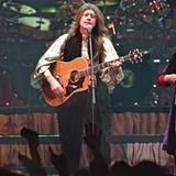 """John Michael Kelly spielt für die Band nicht nur Gitarre und Schlagzeug, sondern ist auch für die Videos der Songs zuständig. Im Jahr 2000 gibt er seinen Ausstieg bekannt, stellt jedoch 2011 für die Band das Album """"The Complete Story"""" zusammen."""