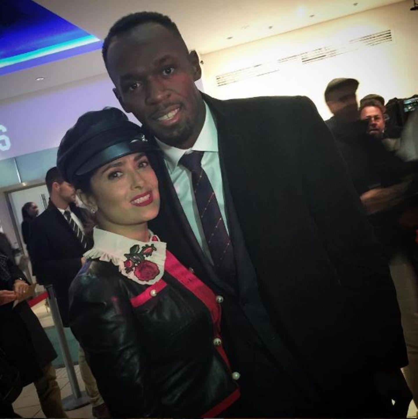 Schnell mal den schnellsten Mann der Welt geschnappt: Salma Hayek lässt sich mit Usain Bolt ablichten.