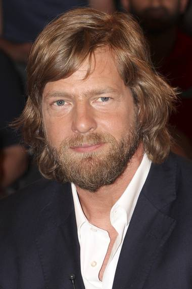 """Neuerdings zeigt sich """"Der letzte Bulle""""-Star Henning Baum mit einer ganz schönen Matte und etwas längerem Bart."""