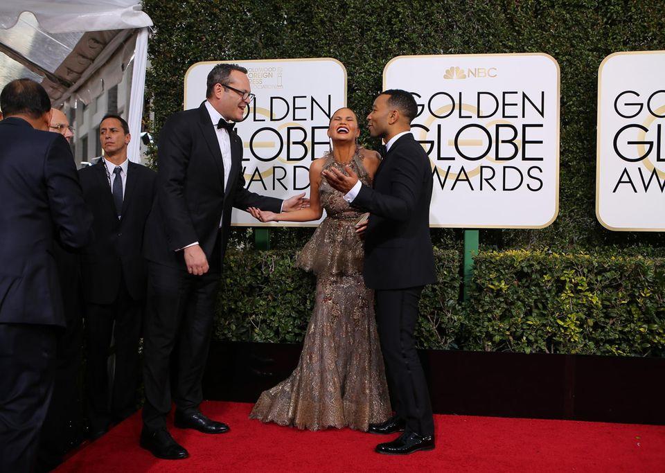 Vince Vaughn hat Chrissy Teigen und John Legend scheinbar etwas sehr lustiges erzählt.