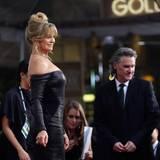 Kurt Russell will Goldie Hawn nicht die Show steheln und hält sich dezent im Hintergrund.