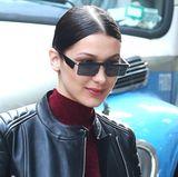 Topmodel Bella Hadid hat zwar keine viereckigen Augen, dafür aber eine stylisch-futuristische Sonnenbrille mit rechteckigen Gläser. Neuer Trend für diesen Sommer?
