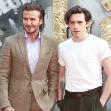 """Von seinem Vater David muss Brooklyn Beckham noch so einiges lernen. Vor allem wenn es auf den Red Carpet geht. Bei der Premiere von """"King Arthur"""" sieht er nämlich so aus, als würde er zum Militär und nicht etwa zu einem Hollywood-Event gehen."""