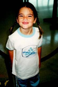Kendall Jenner  Sie war schon als kleines Mädchen ein begehrtes Fotomotiv. Mit ihrem frechen Blick und süßen Zöpfen hat sie jeden um den Finger gewickelt.