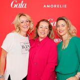 Katja Rechner, Martina Buckenmaier und Maren Guber (alle Riani) feiern ihre gelungene Kollektionspräsentation auf dem GALA Fashion Brunch.