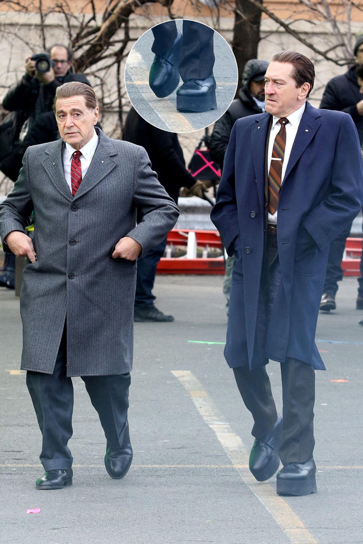 """Am Set des neuen Films von Martin Scorsese """"The Irishman"""" muss sich Schauspieler Robert De Niro mit Hilfe von Plateau-Schuhen größer schummeln, um mit seinen 1,77m neben Kollege Al Pacino größer zu wirken."""