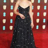 Mit silbernen Blüten und Blättern bestickt ist das Abendkleid von Schauspielerin Florence Pugh.