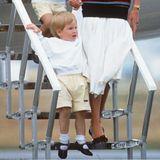 1986  Als königlicher Knirps ist Prinz Harry noch lange nicht der royale Rotschopf, der er heute ist. Damals ist sein Haar noch viel blonder.
