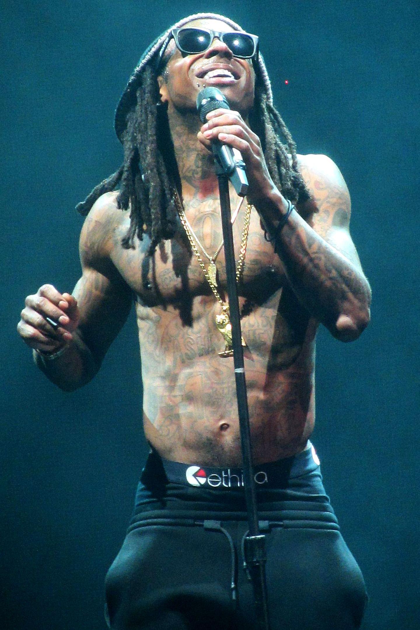 """Lil Wayne  """"Das Mädchen war 13"""", verriet der Rapper. """"Wir spielten Montagsmaler und sie schrieb 'F--- mich' auf das Brett."""""""
