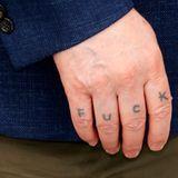 Der umstrittene Regisseur Lars von Trier sorgt mit seinen Tattoos auf den Fingern der rechten Hand für Verwirrung.
