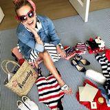 """""""Packen ist leichter, wenn es ein Motto gibt"""", postet Reese Witherspoon scherzend. Bei der Klamottenwahl kann die Schauspielerin sich am 4. Juli ganz einfach an die Farben der US-Flagge halten."""