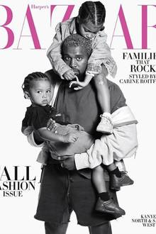 Kanye West mit North und Saint West