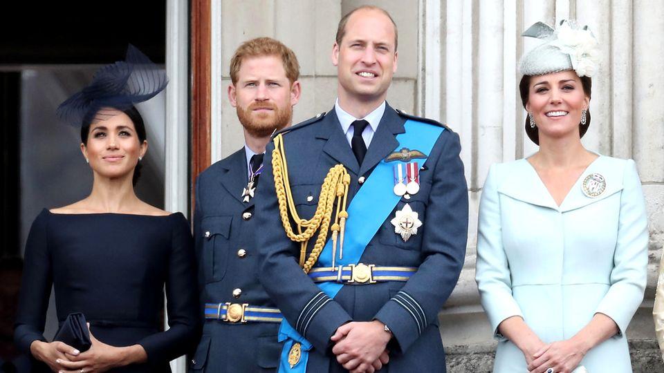 Prinz Harry und Herzogin Meghan, und Prinz William und Herzogin Catherine