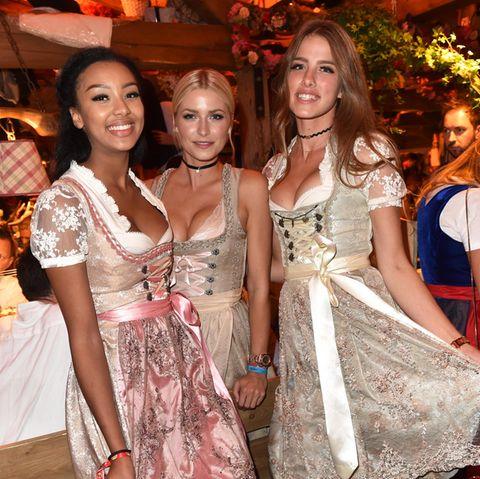 Model Sainabou Sosseh, Lena Gercke und Janna Wiese auf der Wiesn.