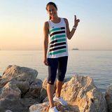 In den Morgen startet Ana Ivanovic mit einer kleinen Sporteinheit. dafür schlüpft sie in ein Set von Adidas.