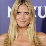 2013  Seitenscheitel, Eyeliner, Lipgloss - in den vergangenen Jahren setzt Heidi Klum mehr und mehr auf dieses Aussehen.