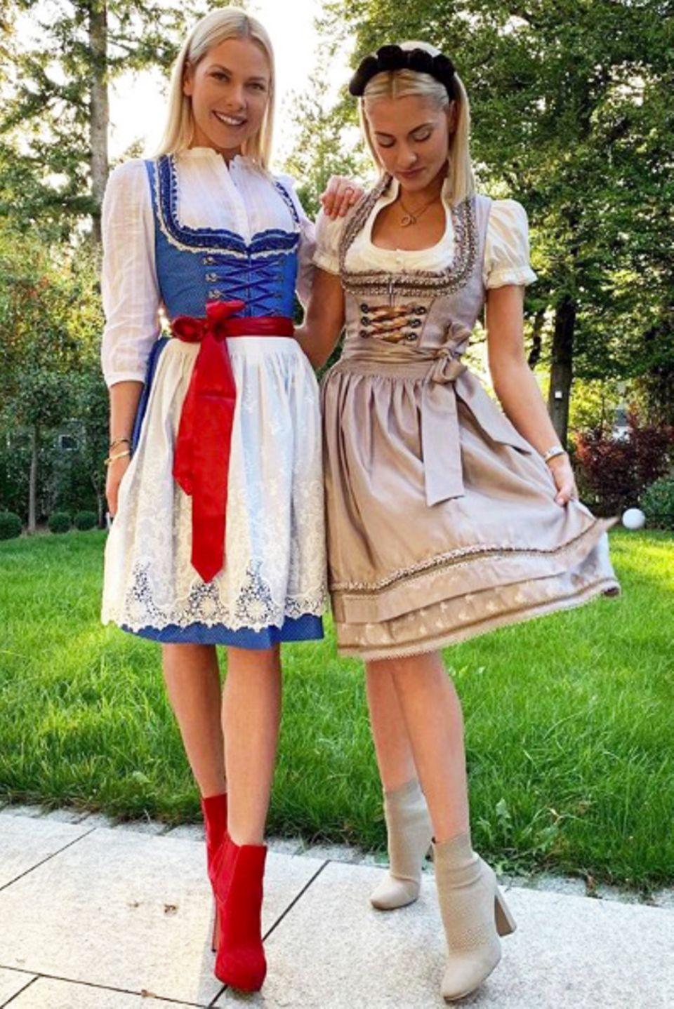 Hübsches Duo: Die Zwillingsschwestern Cheyenne und Valentina Pahde besuchen die Wiesn in diesem Jahr in Valentinas Eigen-Kreationen. Die GZSZ-Darstellerin hat nämlich gemeinsam mit Krüger Dirndl eine eigene Kollektion entworfen und die steht den Schwestern schon mal ganz wunderbar.