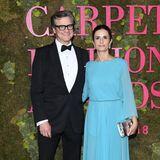 Colin Firth und seine Frau Livia geben sich auf dem grünen Teppich zurückhaltend elegant.