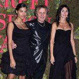 Tina Kunakey,Renzo Rosso und Arianna Alessi haben ihre schwarzen Looks aufeinander abgestimmt.