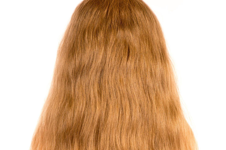 Der zwölfjährige Adrian ließ sich für einen guten zweck die Haare wachsen (Symbolbild)