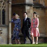 Es ist windig in Windsor, dieweiblichen Hochzeitsgäste müssen gut auf ihre Hüte und Fascinator aufpassen.