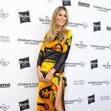 """Echt Vintage! Seit über 10 Jahren hatte Heidi Klum dieses Seidenkleid mit Drachenmotiv von Maison Valentino in ihrem Kleiderschrank hängen, und die """"From Paris With Love""""-Charitygala desChildren's Hospital in Los Angeles war nun die perfekte Gelegenheit, es endlich auch mal zu tragen. Warten lohnt sich eben!"""