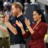 Tag 11  Prinz Harry und Herzogin Meghan jubeln den Spielern des Rollstuhl-Basketballs zu.