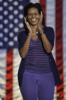 Michelle Obama setzt auf Farben: Im Wahlkampf ihres Mannes zeigte sie sich oft sportlich und leger, setzte eher mit der Farbe ihrer Garderobe Akzente als mit auffälligen Designs.