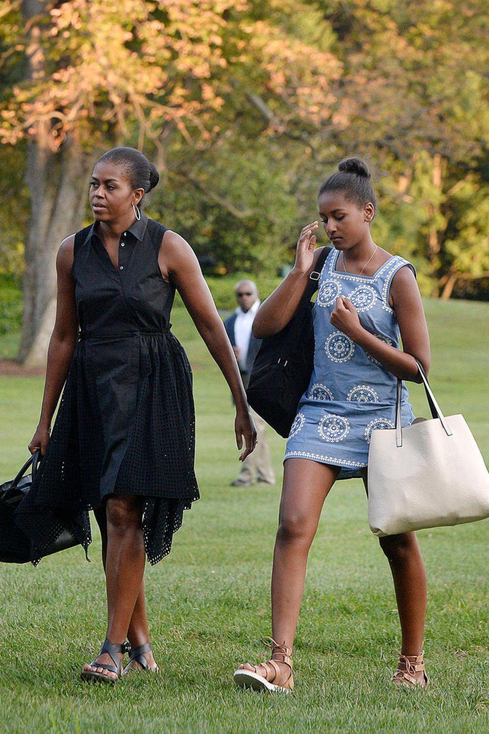 Michelle und Barack Obama mit ihren Töchtern Sasha (r.)und Malla (l.)