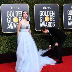 Schauspielerin Alison Brie scheint es in die Menge hinauszuschreien: Dave Franco, ebenfalls Schauspieler, könnte als Robenzupfer eine bessere Performance hinlegen.