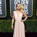 Kristen Bell hat für ihr sexy Kleid die entsprechende Pose gefunden.