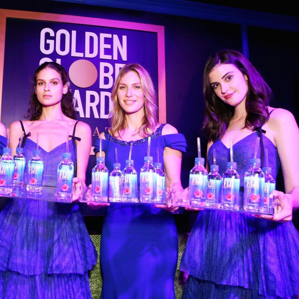 Kelleth Cuthbert (v.r.) ist der unbekannte Star der Golden Globes 2019.