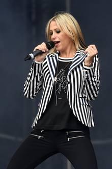 """Natalies jüngere Schwester Nicole Appleton ist ebenfalls ein festes Mitglied der All Saints. Gemeinsam mit der Band steht sie auch heute noch auf der Bühne und singt die gemeinsamen Hits. Rund sechs Jahre istsie mit """"Oasis""""-Sänger Liam Gallagher verheiratet – im Jahr 2014 folgt die Scheidung. Mit dem gemeinsamen Sohn Gene wandert Nicole aus und zieht nach Ibiza, zu einer alten Bekannten ..."""