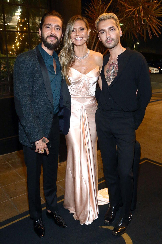Tom Kaulitz (l.) mit Heidi Klum (M.) und Bruder Bill Kaulitz (r.) bei einer Party am17 September2018 in Hollywood