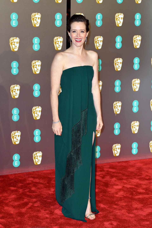 Claire Foy strahlt im dunkelgrünen Abendkleid von Oscar de la Renta.