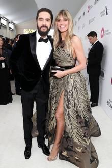 Tom Kaulitz und Heidi Klum, im Traumkleid von Elie Saab, strahlen bei der Viewing Party von Elton John gemeinsam und glücklich in die Kamera.