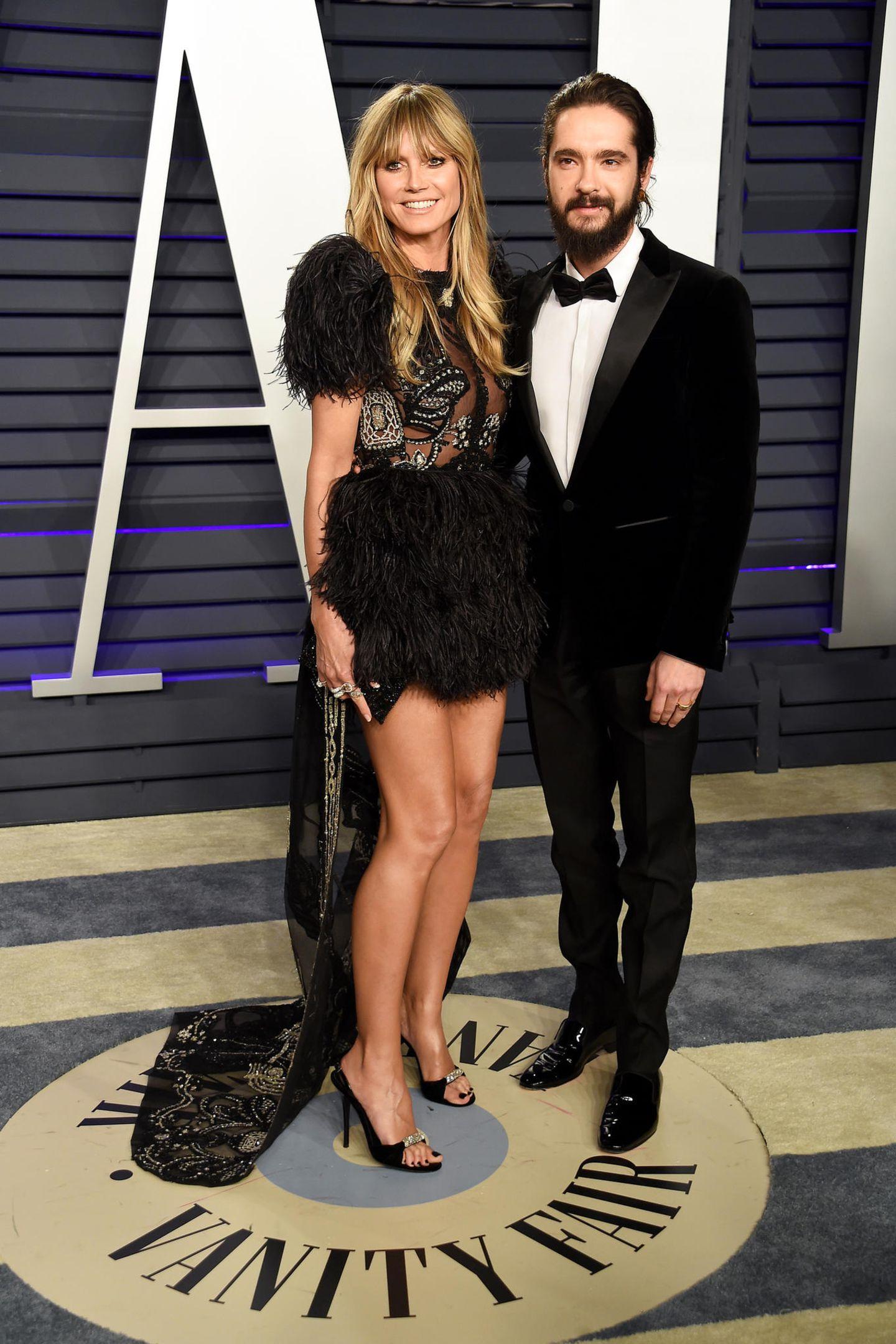 Auch bei der Vanity Fair Oscar Party präsentierensich Heidi und Tom bestens gelaunt und lächeln für die Fotografen um die Wette. Heidi hat für den zweiten Red Carpet an diesem Abend eine neue Robe gewählt, am schönsten lässt sie an diesem Abend allerdings ihre Begleitung strahlen.