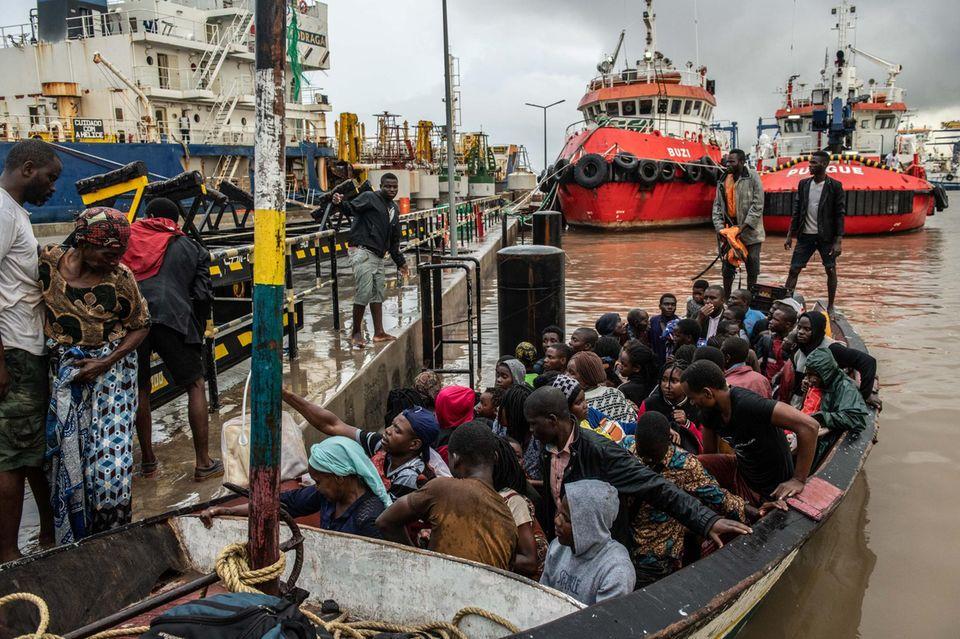 """""""Fab Four""""in Gedanken bei den Opfern: Mehrere Menschen kämpfen nach dem Tropensturm """"Idai"""" in Mosambik, Simbabwe und Malawi um ihr Leben."""