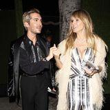 Mit Bill Kaulitz, dem Zwillingsbruder von Heidis VerlobtemTom, versteht sich das Topmodel offensichtlich blendend. Auch modisch scheinen die beiden auf einer Wellenlänge zu sein. Im glamourösen 70ies-Glitzer-Look flanieren sie durch Los Angeles, auf dem Weg zur Geburtstagsparty von Diana Ross - die Disco-Legende feiert ihren 75. Geburtstag.