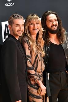 """Heidi Klum zwischen Bill Kaulitz und Tom Kaulitz bei den""""About You"""" Awards."""