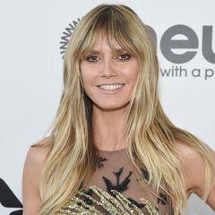 Staffel 14  Während GNTM im Fernsehen läuft, zeigt sich Heidi Klum plötzlich ziemlich verändert. Auf der Oscars-Party von Elton John erscheint sie mit einem helleren Blondton und einem Pony. Was für ein Cut!