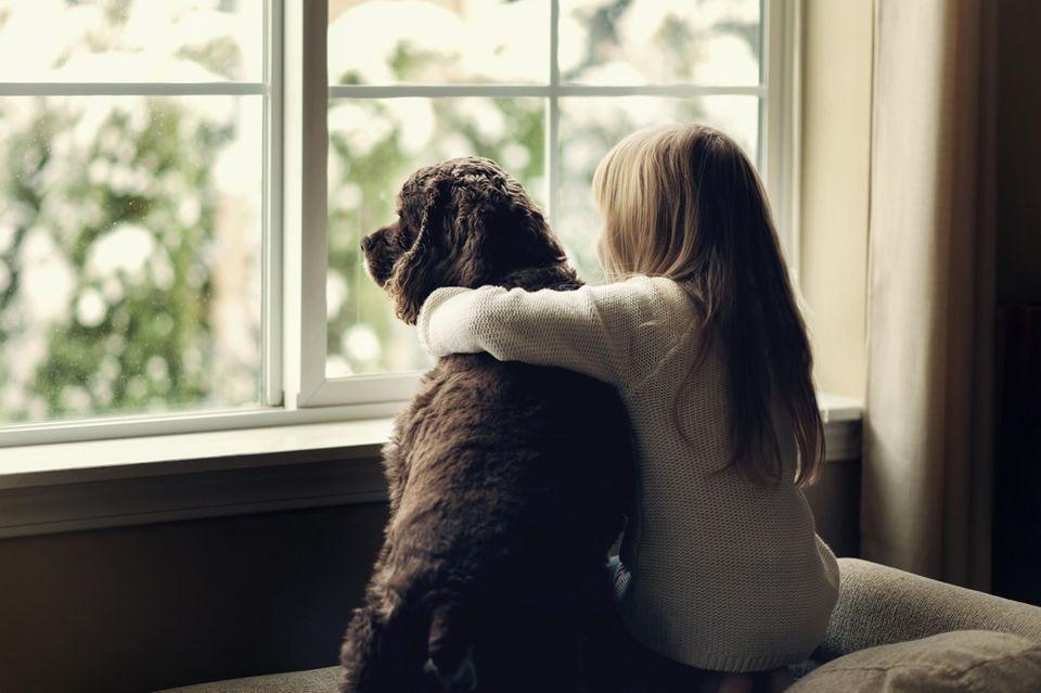 Kinder, die mit Hunden aufwachsen, sind oftmals gesünder als andere Kinder.