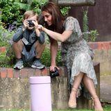 25. Juni 2019  Herzogin Catherine besucht einen Fotografie-Workshop für benachteiligte Kinder. Von Queen Elizabeth ist ihr die Schirmherrschaft der Royal Photographic Society übertragen worden.