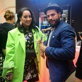 Cheers: Miyabi Kawai und Manuel Cortez stoßen auf die gelungene Fashion Show von Anja Gockel an.