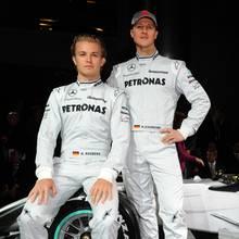 Nico Rosberg (l.) und Michael Schumacher (r.)