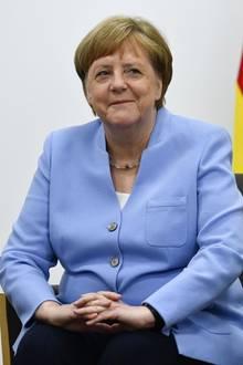 Angela Merkel setzt sich beim G20-Gipfel in Osaka modisch in Szene. Im Laufe ihrer Karriere hat sie gelernt, Farben für sich sprechen zu lassen.