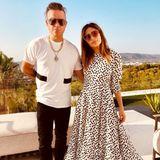 Schwarz oder weiß - egal, Hauptsache zusammen! Robbie Williams und Ayda Field präsentieren einen der schönsten Date-Looks dieses Sommers. Besonders herzig: Aydas Sonnenbrille.