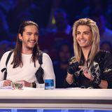 """2013  Die vorherigen Jahre ist es in Deutschland still um Tokio Hotel geworden. Doch nun sind Tom und Bill zurück im Fernsehen. Sie sitzen in der Jury von """"Deutschland sucht den Superstar"""" - Bill mit blondem Haar und Tom mit gefilzten Spitzen."""