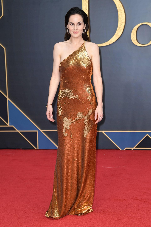 """Ein Hingucker am roten Teppich ist SchauspielerinMichelle Dockery bei der Premiere des Kinofilms von """"Downton Abbey"""" allemal. Die Pailletten-Robe des LabelsGalvan setzt noch das i-Tüpfelchen drauf."""